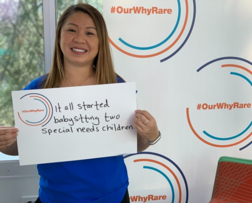"""Amy shows poster that says, """"It all started babysitting two special needs children."""""""