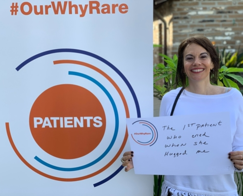 """Christine shows a poster that says, """"The 1st patient who cried when she hugged me."""""""